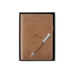 journal en cuir et crayon